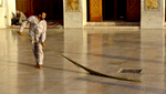 Courtyard sweeper at the Umayyad Mosque.