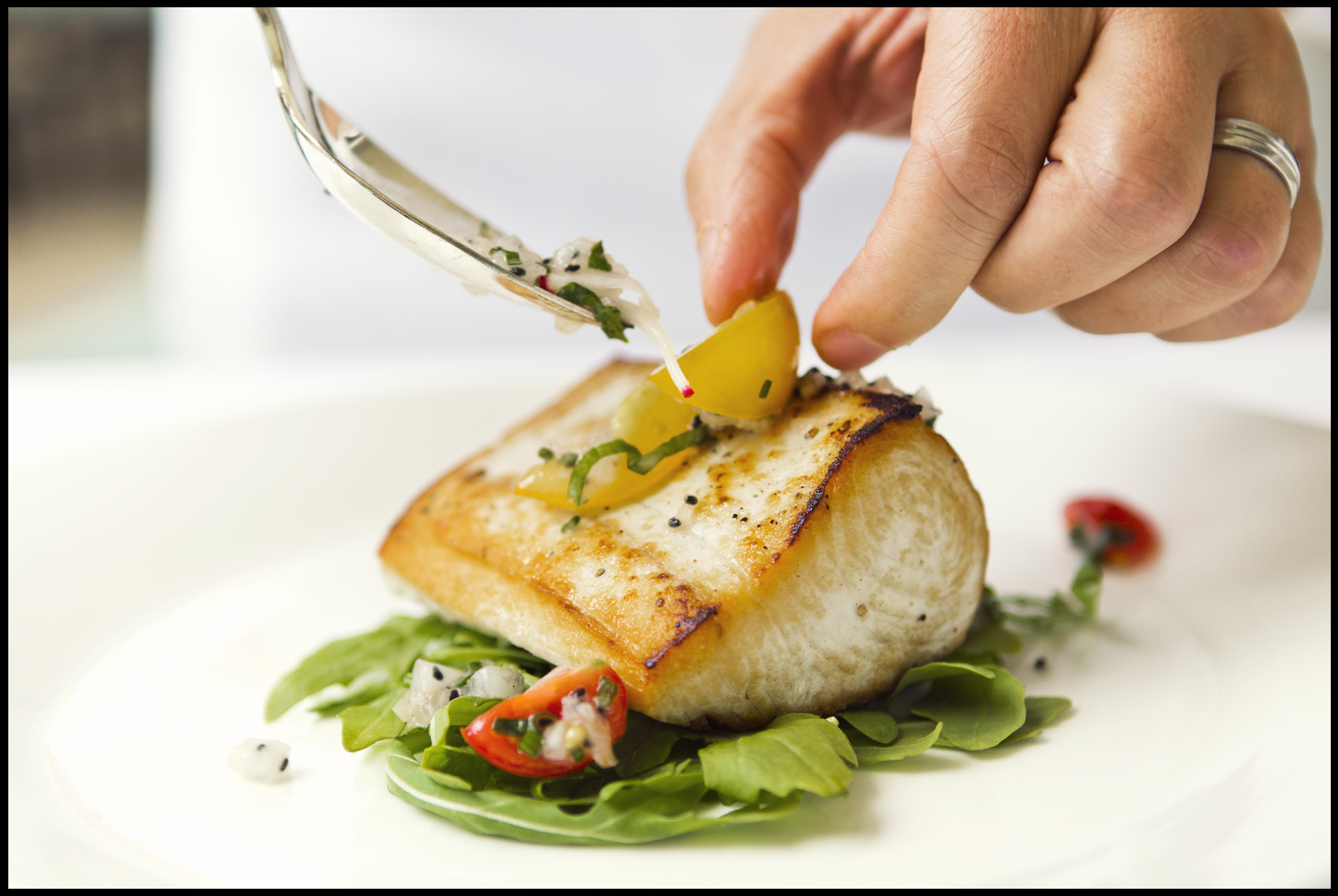 Four Seasons Maui executive chef Roger Stettler prepares a fresh fish dish at the resort.