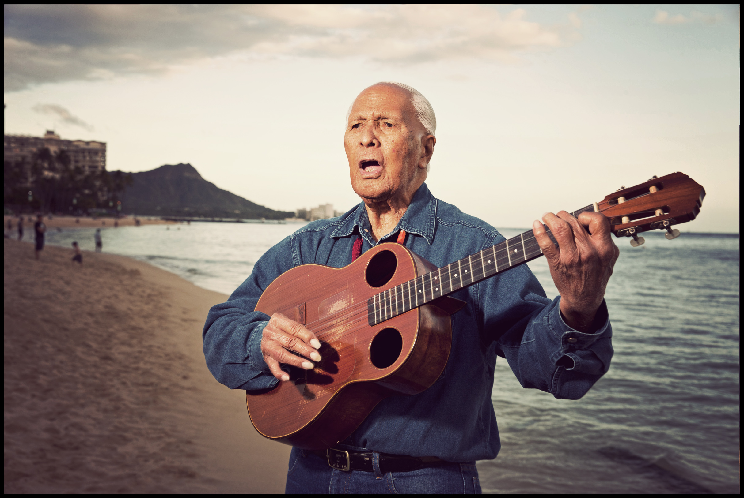 Ukulele legend Eddie Kamae on Waikiki Beach for The Los Angeles Times.