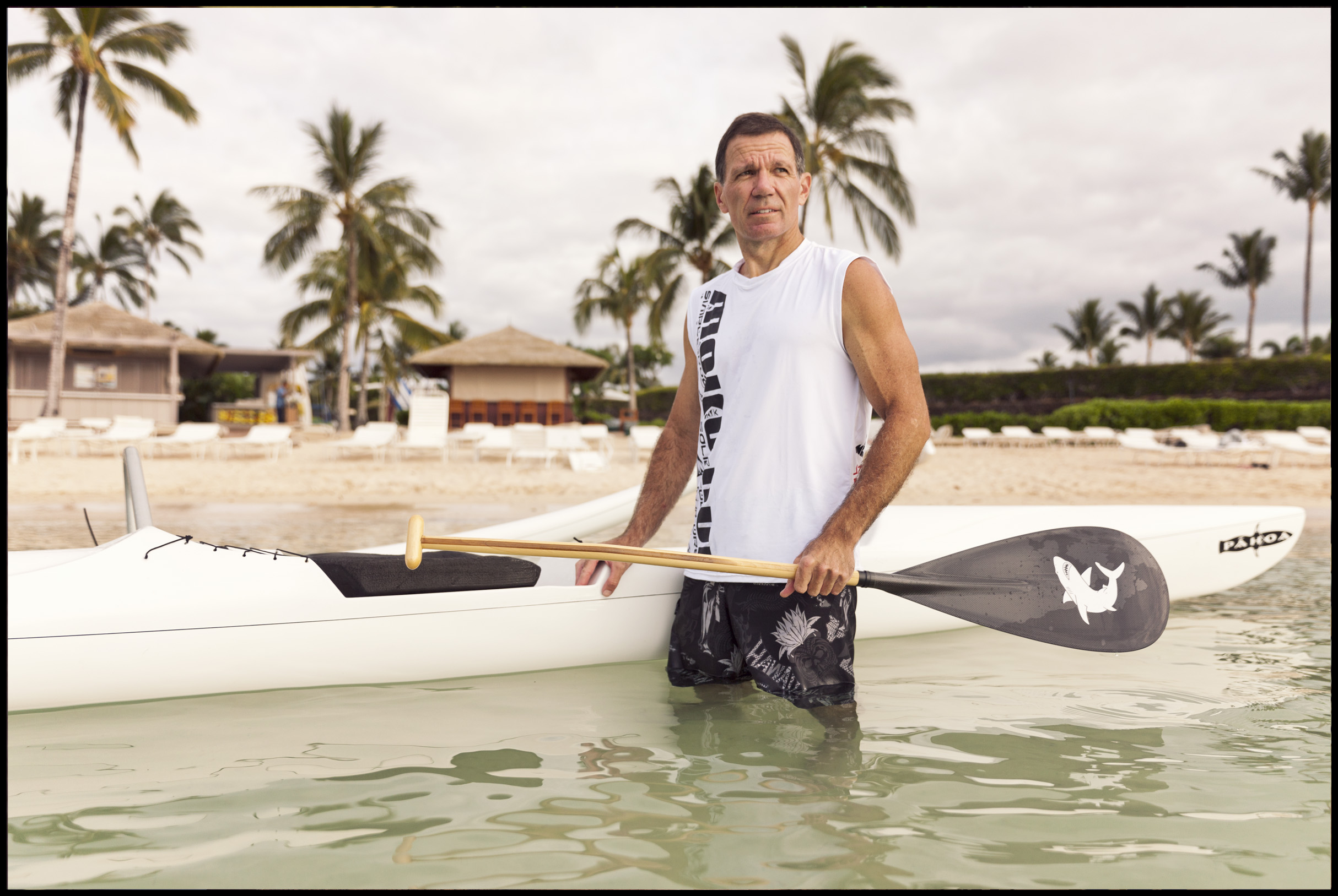 Fairmont Orchid general manager Chris Luedi finishes his one man canoe workout in the resort's lagoon.  Image for The Wall Street Journal.