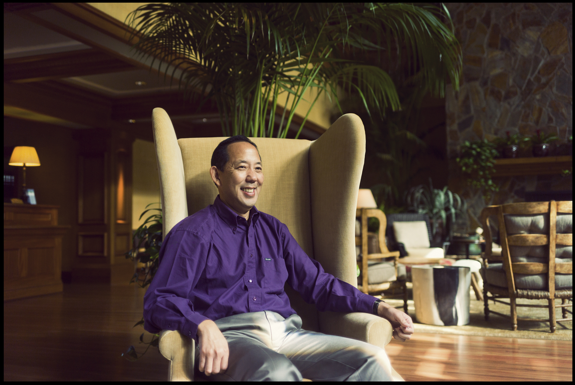 Kurt Matsumoto, COO of Lanai Resorts, sits inside the Four Seasons Lodge.  Image for The Wall Street Journal.