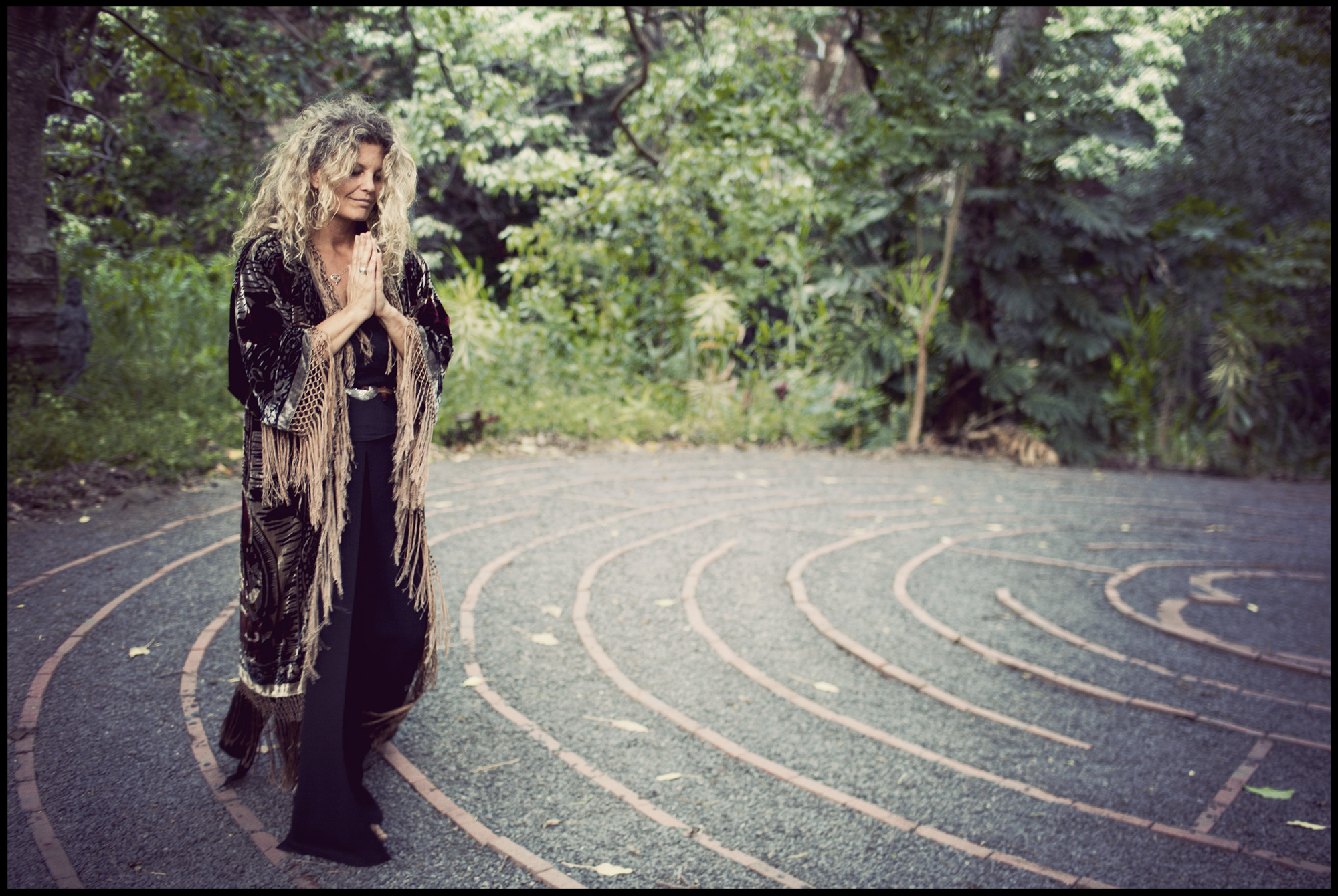 Eve Hogan, a practitioner for Spirit Quest, walks around a labyrinth at The Sacred Gardens of Maliko on Maui.  For Delta Sky Magazine.