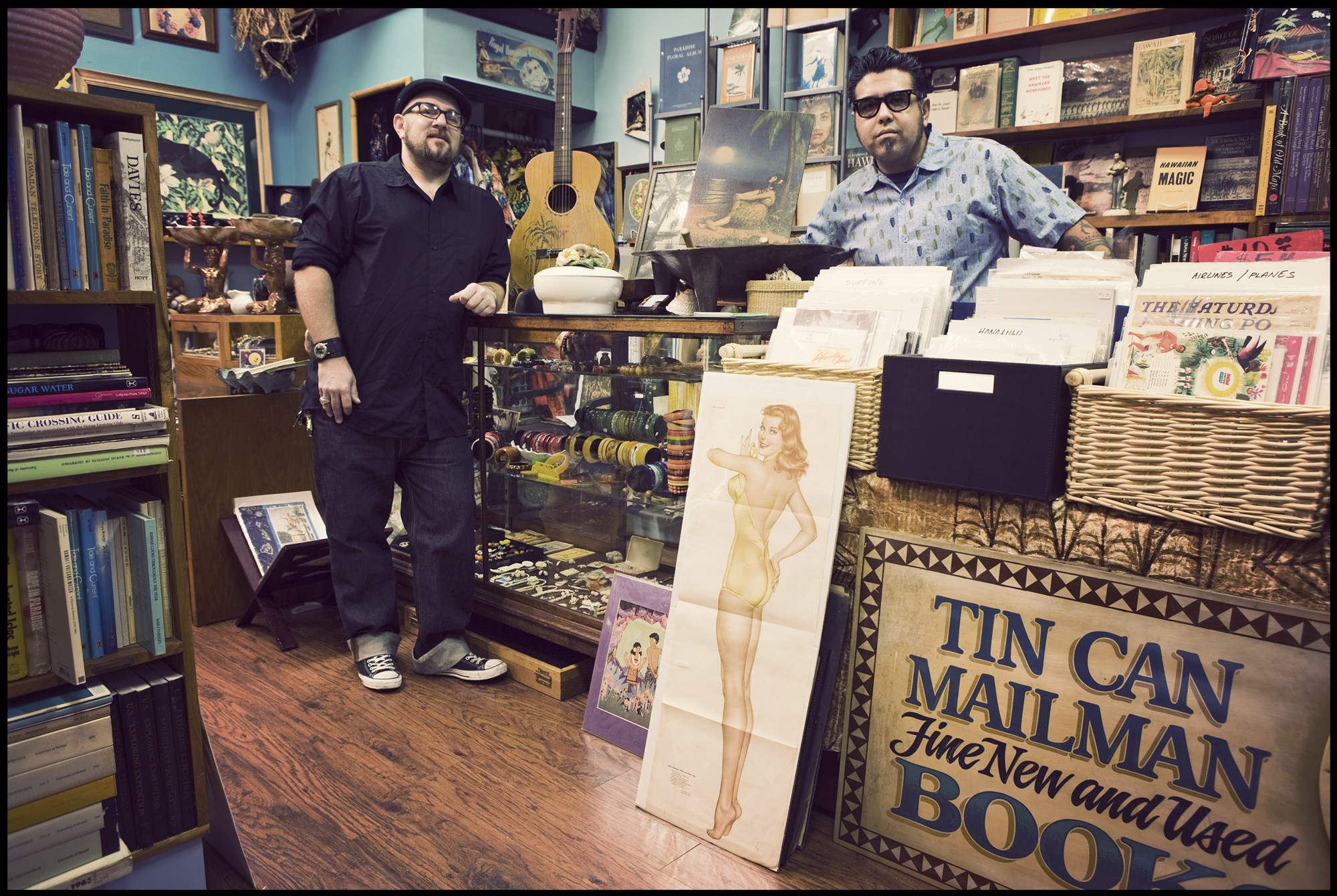 Christopher Oswalt and Raul Sanchez at their vintage shop, Tin Can mailman in Honolulu.