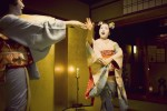 Two geishas play Ozashiki-Asobi, or traditional geshia games, for guests at a ryotei in Kyoto.