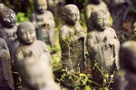 O-jizo sama, or prayer statues outside a temple in rural Japan.