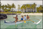 Guests paddle out with Hawaiian beachboys at the Fairmont Orchid Resort on the Big Island.  Image for the Fairmont Orchid Resort.