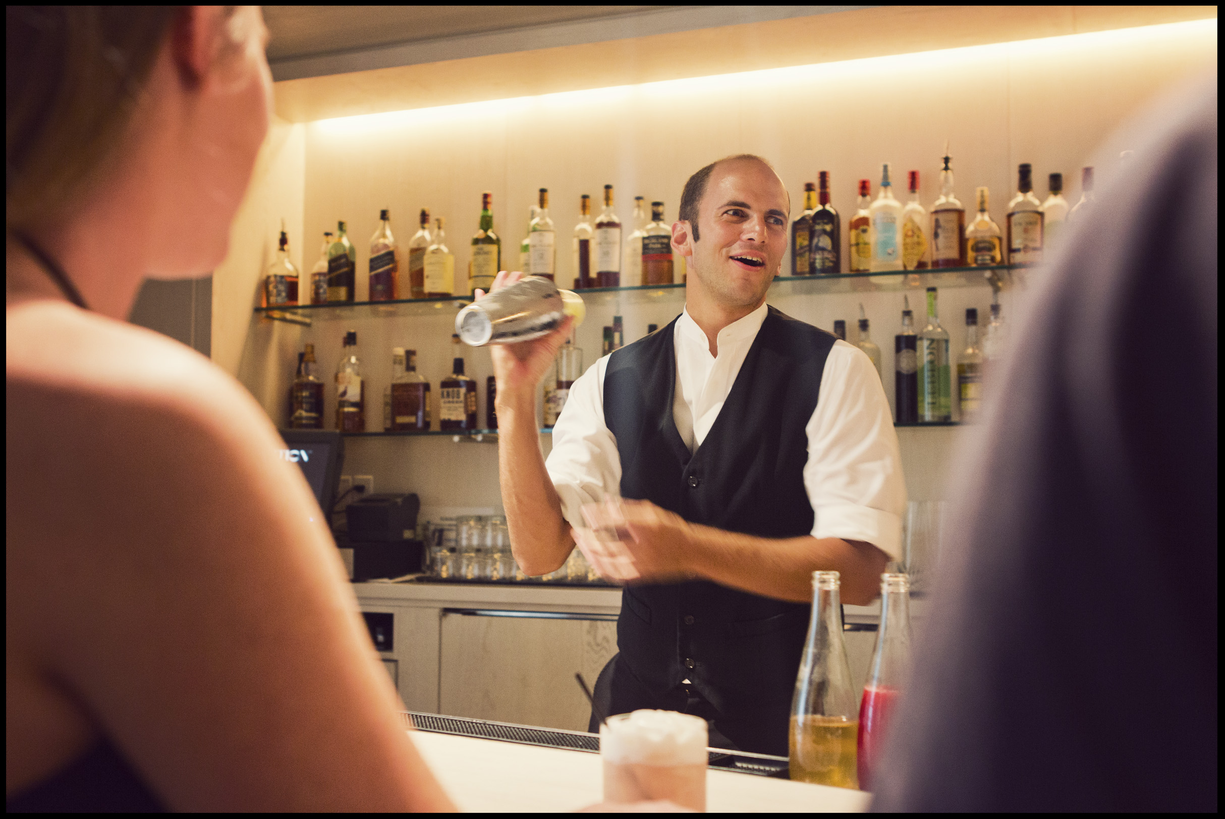 The Bartender at The Study serves drinks at the Modern Honolulu.