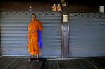 A saffron colored robe adorns a monk in Bangkok.