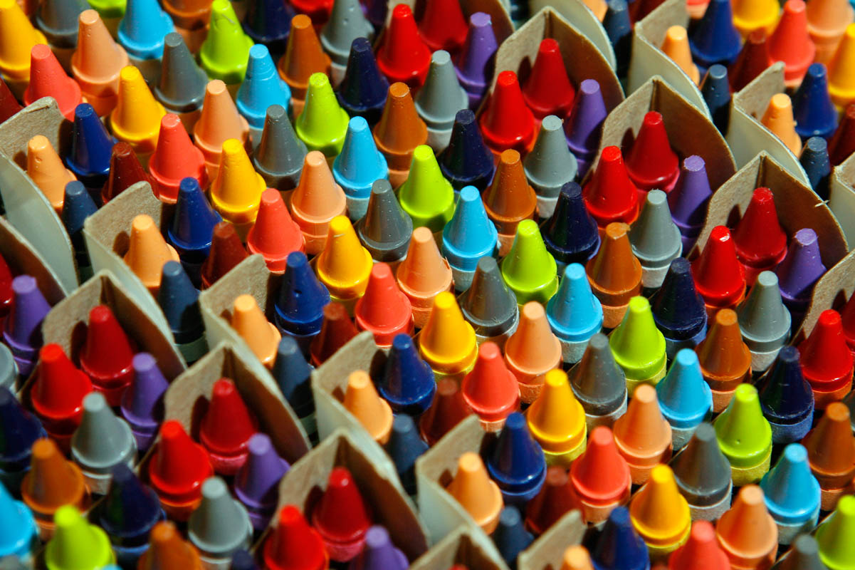 Rows of colorful crayons on an assembly line at Crayola