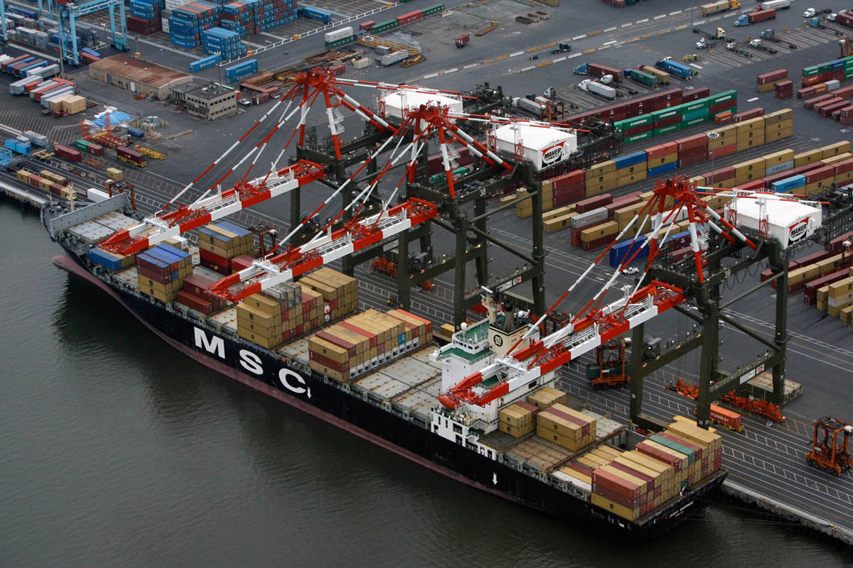 Aerial of intermodal containers being unloaded from a ship at Maher Terminals in Port Newark, New Jersey