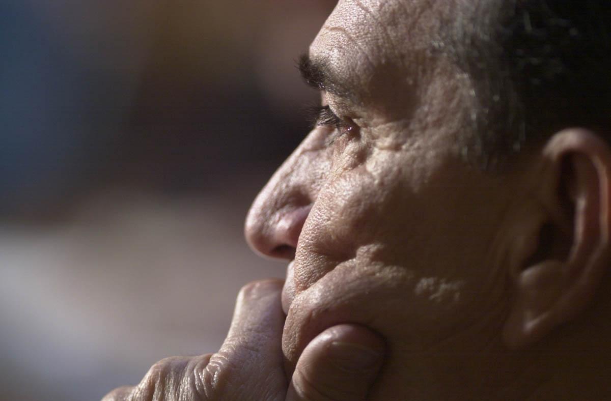 Portrait of older man listening to someone speak