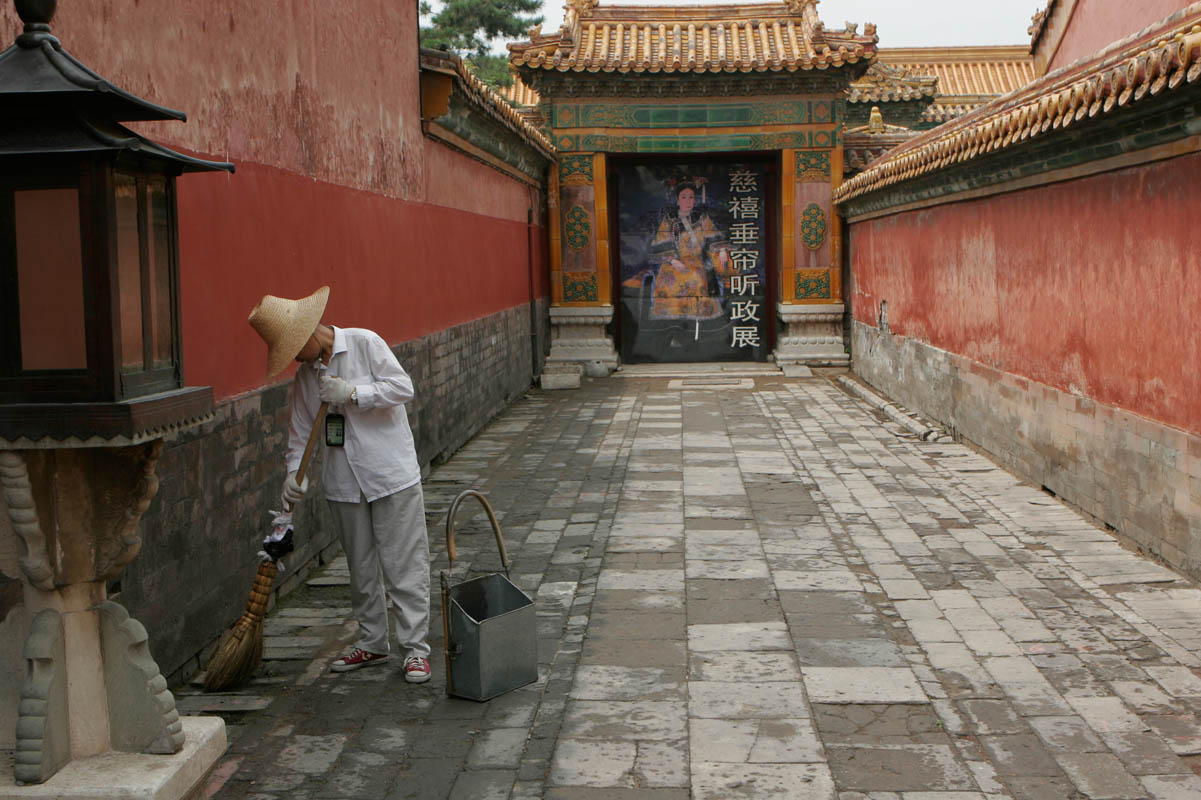 A worker sweeping inside the Forbidden City, Beijing, China.