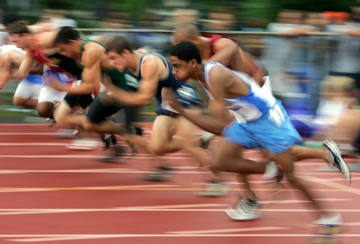Runners explode off the start of a boys 100 meter heat race during the NJSIAA Track and Field State Group Championships at Frank Jost Field in South Plainfield, New Jersey.