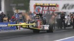 Clay Millican lifts the front end of his dragster at the start of a run down the quarter mile strip during the NHRA Supernationals at Raceway Park in Old Bridge, New Jersey.