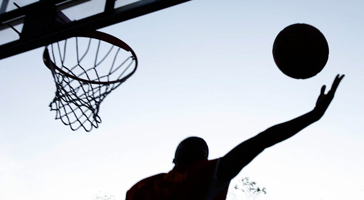 A player grabs a rebound during an adult summer basketball league at Saint Peters Park in Newark, New Jersey.