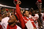 Rutgers head coach Greg Schiano joins his players to celebrate their victory over Pitt as the Scarlet Knights played the University of Pittsburgh Panthers at Heinz Field in Pittsburgh, Pennsylvania.