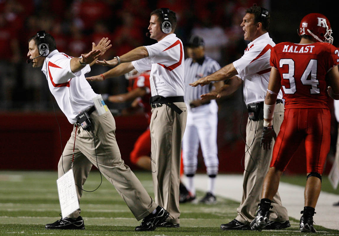 Rutgers head coach Greg Schiano(left) reacts to a call on the sidelines during 28-23 loss to Cincinnati, at Rutgers Stadium in Piscataway, New Jersey. Rutgers football coach Greg Schiano has taken the program from the worst ranked Division 1 team to a nationally ranked contender.
