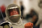 A fencer celebrates after winning his Sabre match during the NJSIAA State Fencing Championships at Rider University in Lawrenceville, New Jersey.