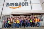 Group photo of culturally and racially diverse Management Team standing outside the Amazon Fulfillment Center in Edison, NJ on 12/12/18.