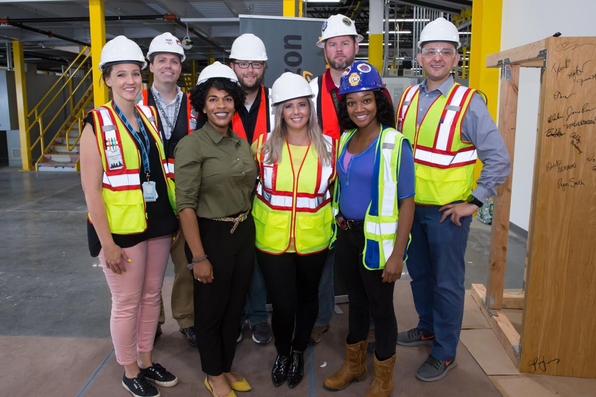 Group photo of culturally and racially diverse Amazon Management Team after tour of the new Amazon Fulfillment Center, in West Deptford, NJ on 8/17/18.