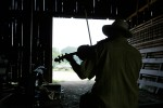 A musician warms up in an equipment barn before performing at the 20th Annual Old Time Fiddle Contest at the Howell Living History Farm in the Titusville section of Hopewell Township, New Jersey