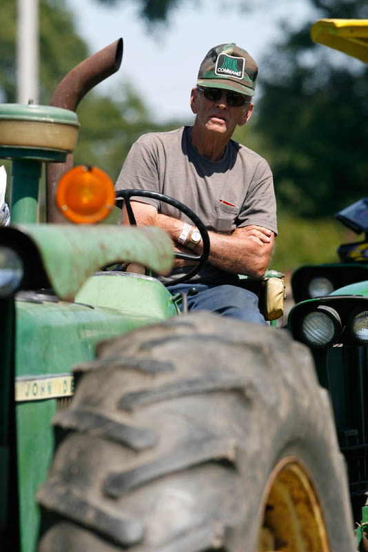 A farmer waits on his John Deere tractor to compete in the tractor pull at the Hunterdon County 4-H Fair at the county fairgrounds in West Amwell, New Jersey