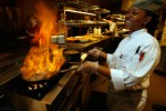 A chef works at the flambe station at the Waterfront Buffet at Harrah's Marina Casino in Atlantic City, New Jersey
