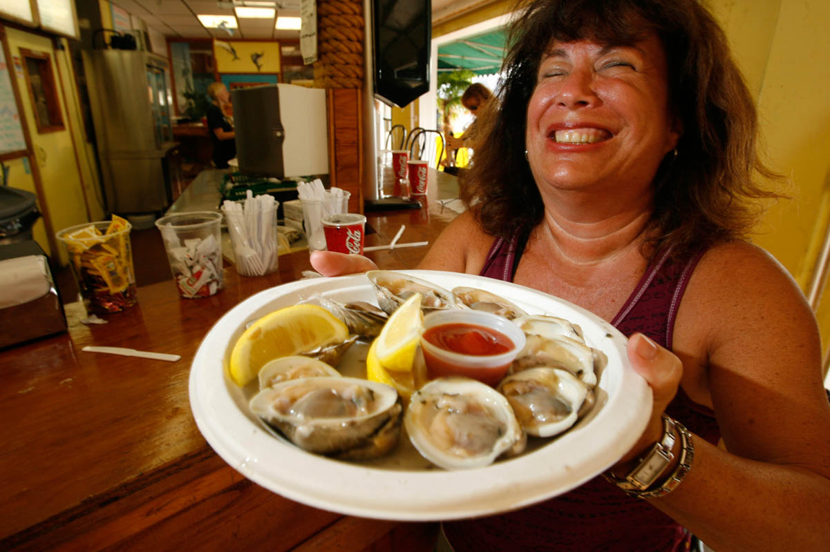 Seafood lover with clams on the half shell at a restaurant on the Jersey Shore.