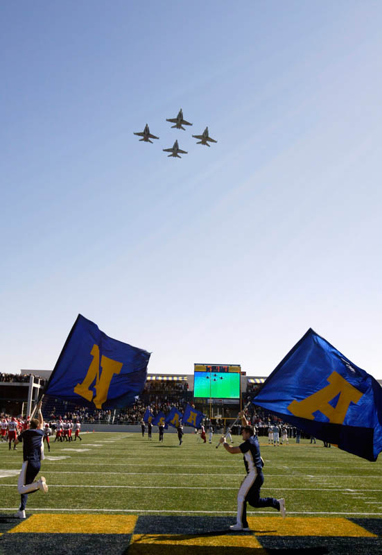 US Navyjets fly over stadium before  Navy football game at the Navy-Marine Corps Memorial Stadium in Annapolis, Md