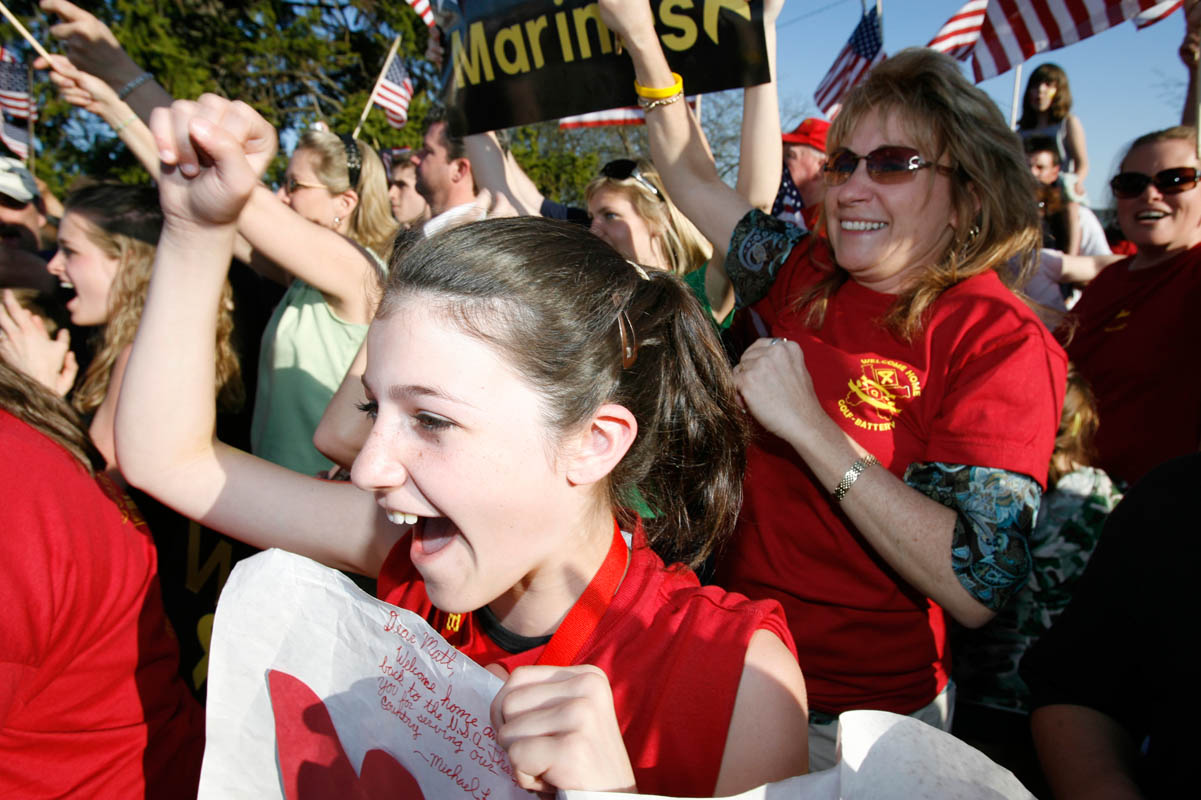 Family and friends cheer as United States Marines return from a seven month tour in Iraq..