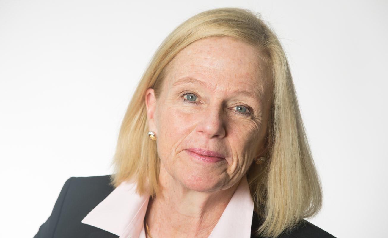 Headshot of Female Executive on a white backdrop