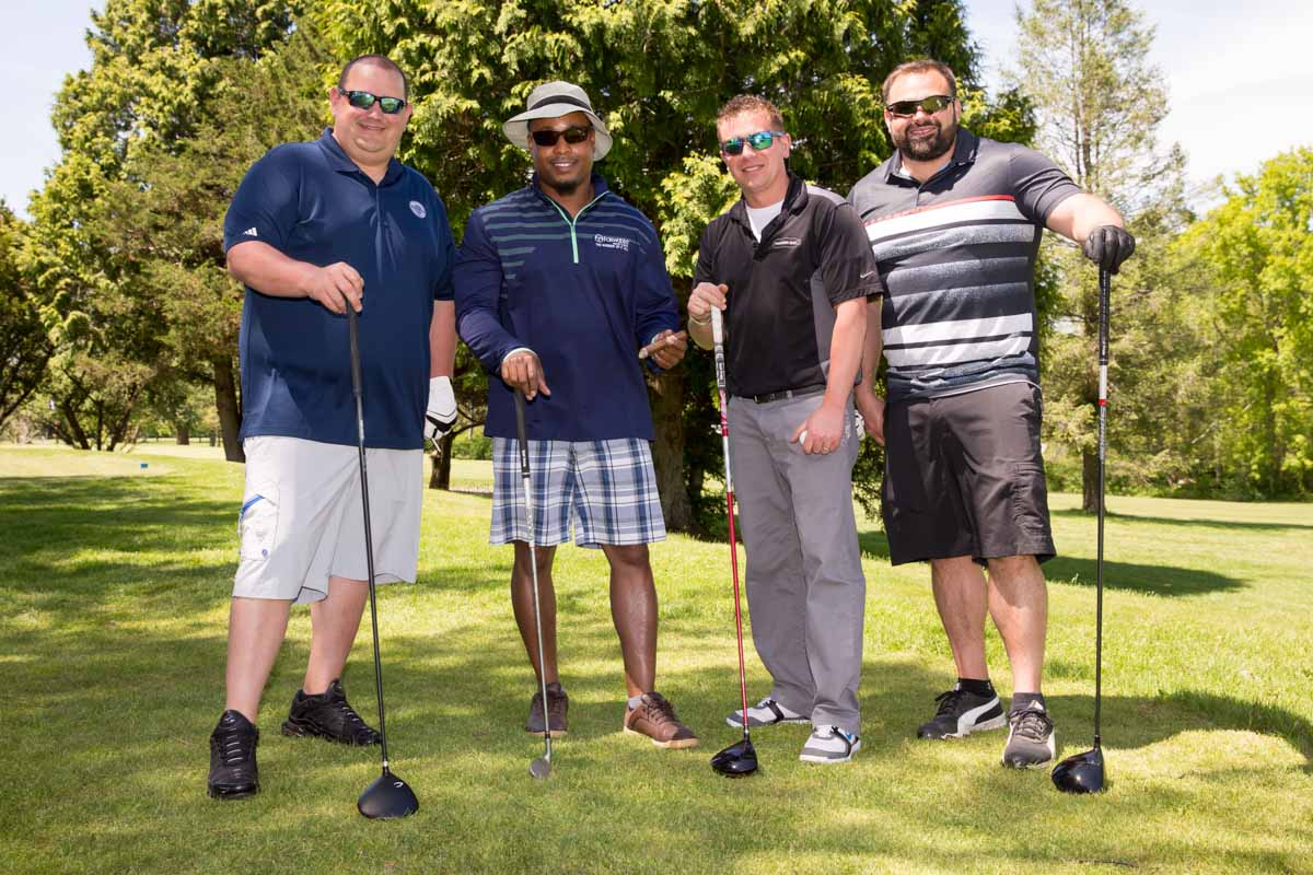Golf foursome standing together at golf club during Eastern Energy Expo at Foxwoods Resort and Casino in Mashantucket, CT on 5/21/18.