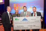 Four men standing together during a check presentation at the Eastern Energy Expo at Foxwoods Resort and Casino in Mashantucket, CT on 5/22/18.