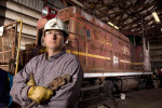 Owner of a Locomotive Rebuilding Service, stands with one of historic locomotives