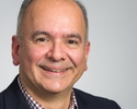 Headshot of a hispanic business man.
