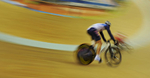 Riders compete in men\'s individual pursuit cycling track race event on day eight of the 2008 Beijing Olympics in China. Photo by Victor Fraile --- Image by © Victor Fraile/Corbis
