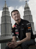 Red Bull Racing Team  driver David Coulthard poses in front of the Petronas Twin Towers in Kuala Lumpur, Malaysia