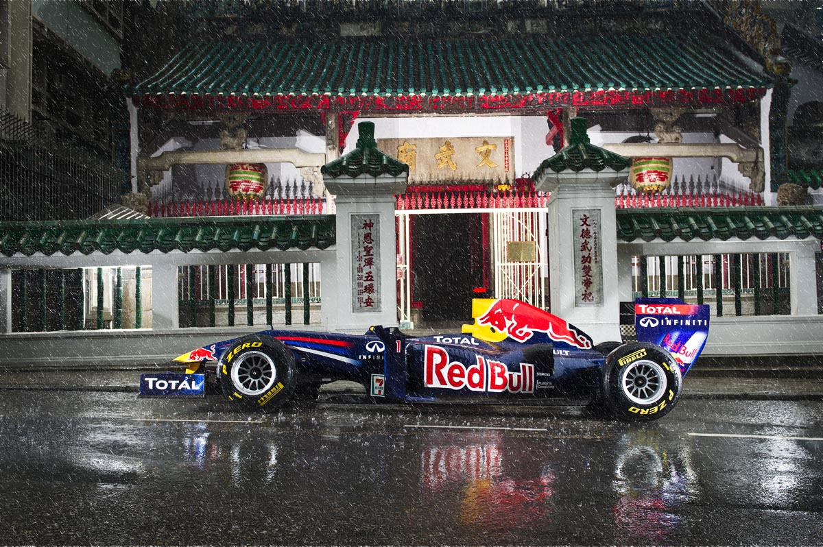 Red Bull Racing Formula One RB7 car pictured in front of Man Mo Temple in Hong Kong