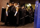 Marian Catholic Marching Band Drum Majors Kaitlyn Van Tuyl, (from left), Diamond Murphy, and Samantha Greene, embrace before taking the field during the semi-finals at the Bands of America Grand National Championships at Lucas Oil Stadium on Saturday November 14, 2009.