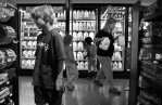 Patty Mueller grabs milk from the grocery while her children eye other items on Wednesday September 9, 2009.