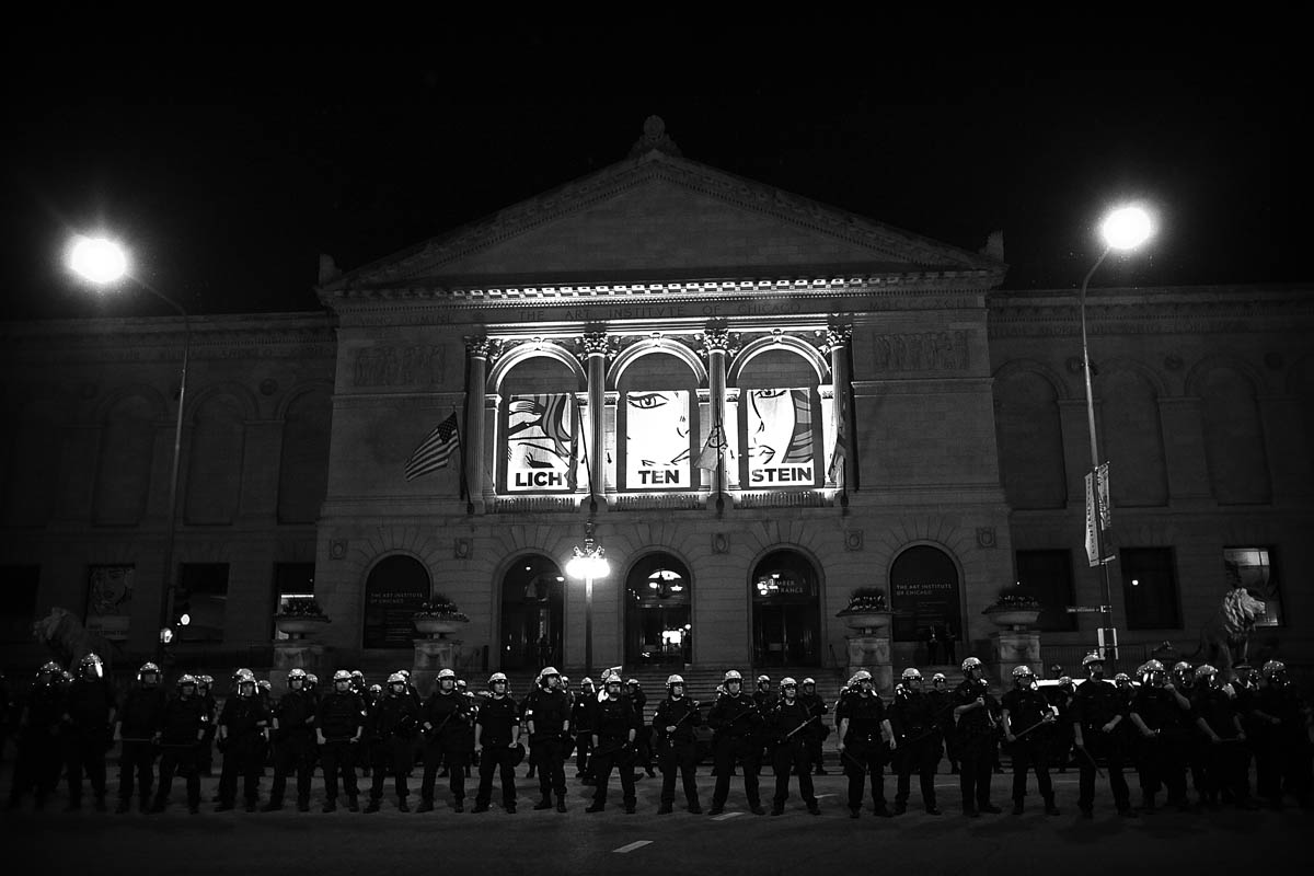 Members of the Chicago Police Department line the streets of Michigan Ave. protecting the Art Institute of Chicago as protesters march towards thier position in downtown Chicago during the NATO Summit on Sunday May 20, 2012.
