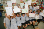 Students from the Jumeirah English Speaking School (JESS) take part in a class where they can ask the explorer Adrian Hayes questions about his recent expedition to Greenland, in Dubai on June 8, 2009.