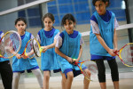 Young girls aged between 8-11 years participate in a sports class at the Aspire Academy in Sport City, Doha, Qatar, on March 24, 2008. The girls were selected on the basis of their skill level and fundamental sporting ability.