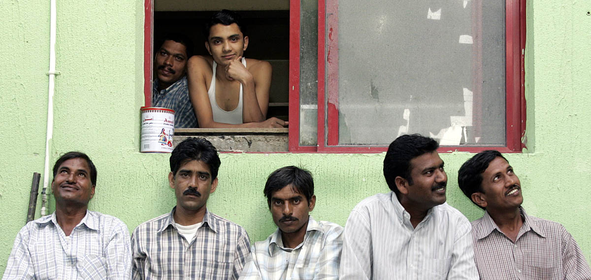 Men from a labour camp in the Al Quoz district of Dubai during a day off.
