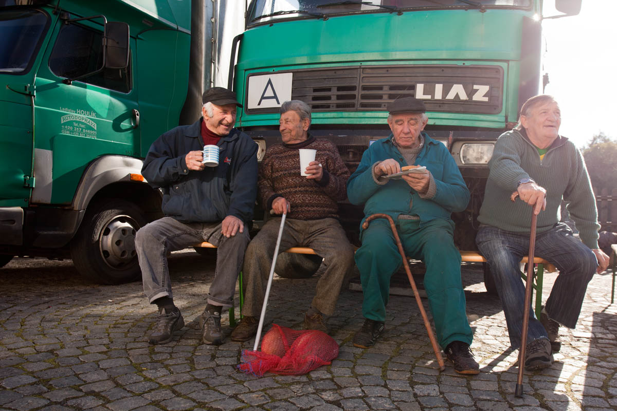 Men sit together during a traditonal carp harvest in the village of Kondrac, Czech Republic, on October 13, 2012.