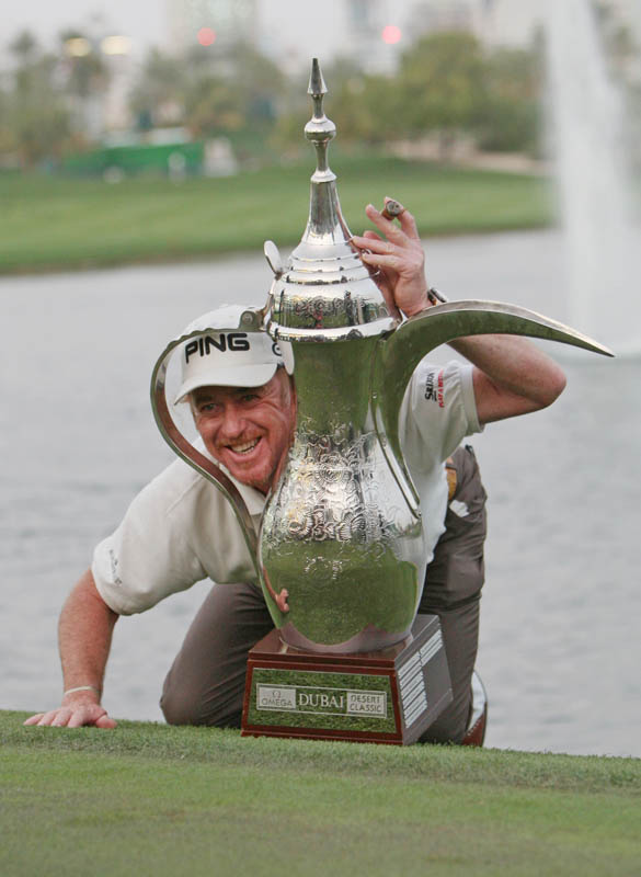 Miguel Angel Jimenez of Spain pictured with the winner's trophy on the final day of the Omega Dubai Desert Classic golf championship held at the Majlis course at the Emirates Golf Club in Dubai on February 7, 2010.