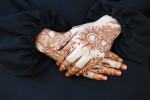 A UAE girl with traditional henna paint on her hands in Umm Al Quwain.