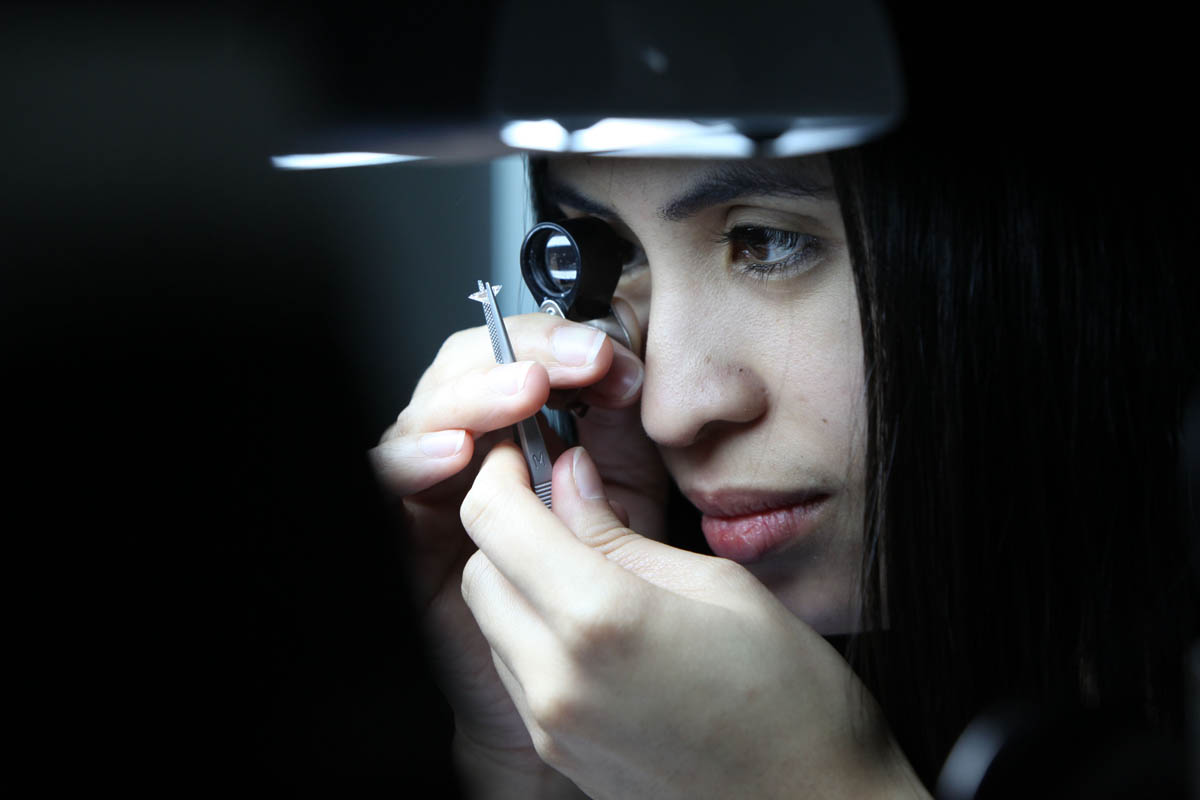 Anabel Hosena, a diamond grader, checks over a diamond at the International Gemological Institute (IGI), a scientific laboratory for the identification and grading of diamonds, coloured stones and fine jewellery, in Dubai, United Arab Emirates, on February 8, 2011.