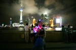 "The Bund area, an elevated riverside promenade beside the Huangpu River, in Shanghai on September 15, 2008. In this photo a vendor hawks glow-in-the-dark devil horns while the Pudong business district can be seen across the river. The World Expo 2010 will be hosted by Shanghai with the theme  ""Better City-Better Life"" highlighting the city's newfound status as a major economic and cultural hub."