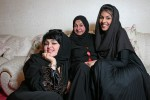 Ameera, Fatma and their mother Samia, pictured in their home for a story on UAE women.